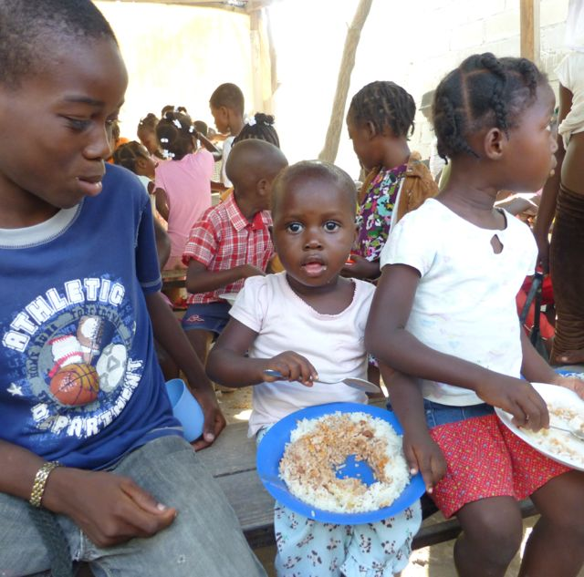 Children eating at food program