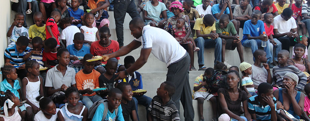 A man passing out food.